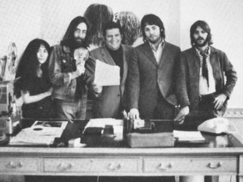 Klein with John Lennon, Paul McCartney, and Ringo Starr.